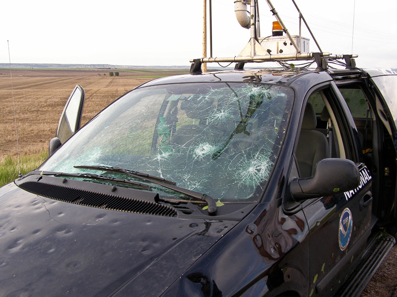 Hail damage on NSSL mobile mesonet vehicle