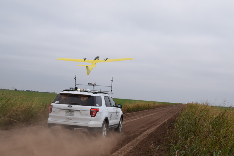 Fixed wing unmanned aircraft being launched